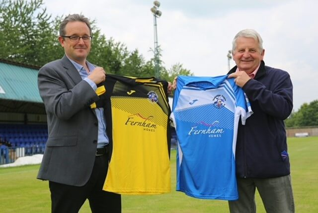 Fernham Homes director and Angels' Chairman holding shirts